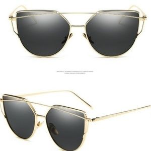 Oversized black and gold sunglasses